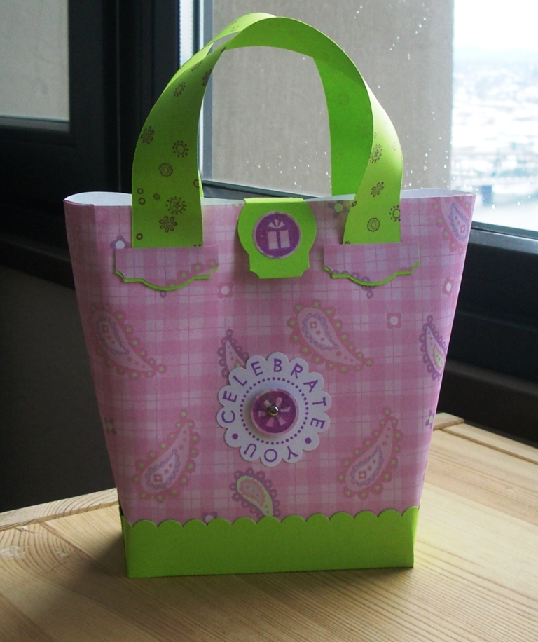 paper purse Use template to cut out purse from card stock and gussets from paper cut on solid lines, use a bone.
